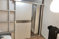 Freestanding-wall-divider-with-a-sliding-door